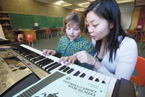 St. Gabriel's school Grade 3 student Jenna Belanger, 9, gets a piano lesson from Carmen Tong, a McGill Piano Performance and Physiology student and the Volunteer Coordinator for the Montreal branch of the Heart of the City Piano Program.  Turn to page 6 to read about the program, which is entirely run by McGill student volunteers. / Photo: Owen Egan