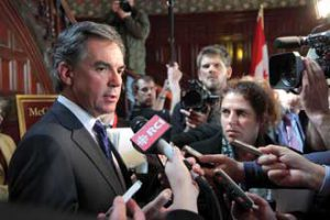 Environment Minister Jim Prentice speaks to reporters following his keynote. / Photo: Owen Egan
