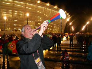 Bob Babinski blows his own vuvuzela outside of Cape Town's Greenpoint Stadium prior to the Round of 16 match between Spain and Portugal.