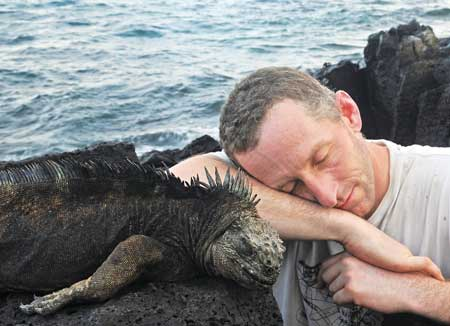 Sleeping with the iguanas: Biology professor Andrew Hendry hard at work with a colleague during a 2012 field  trip to the Galapagos Islands. / Photo courtesy of Andrew Hendry