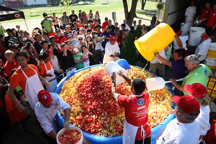 Volunteers put the finishing touches on McGill's record-breakling, 11,197 pound fruit salad in 2012. / Photo: Adam Scotti