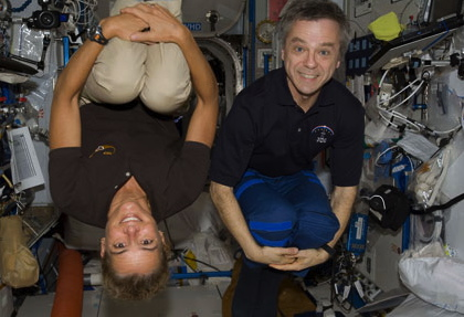 Canadian Space Agency astronauts and McGill alums Julie Payette (BEng'86) and Robert Thirsk (MD'82) pose for a photo in the Destiny laboratory of the International Space Station in July 2009. / Photo courtesy of NASA