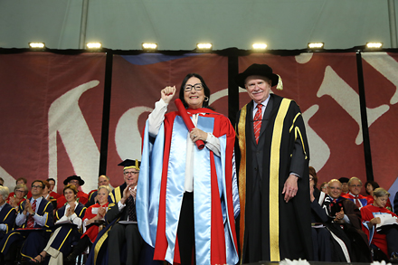 Nana Mouskouri receives her honorary degree from Chancellor Arnold Steinberg. / Photo: Owen Egan