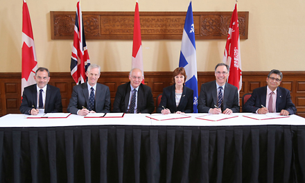 From left to right: Jean-Marc Fritschy, Director, Neuroscience Center Zurich; Nick Rawlins, Pro-Vice-Chancellor for Development and External Affairs, Oxford; Christopher Kennard, Head, Nuffield Department of Clinical Neurosciences, Oxford; Heather Munroe-Blum, Principal and Vice-Chancellor, McGill; David Eidelman, Vice-Principal (Health Affairs) and Dean of Medicine, McGill; and Claudio Cuello, Chair, Brain@McGill at the June 25 signing of the tripartite agreement. / Photo: Owen Egan.