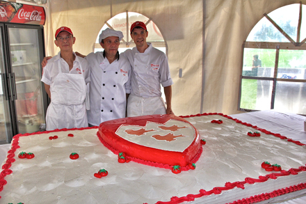 (From left to right) Vanmnh Tran, Paul De Rosendes and Maxime Lessard in front of their creation; a 500-pound tomato cake. / Photo: Neale McDevitt