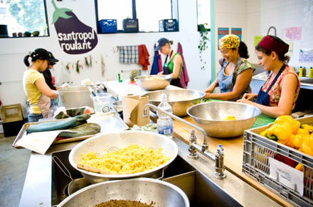 Volunteers help prepare meals in Santropol Roulant's kitchen. / Photo courtesy of Santropol Roulant