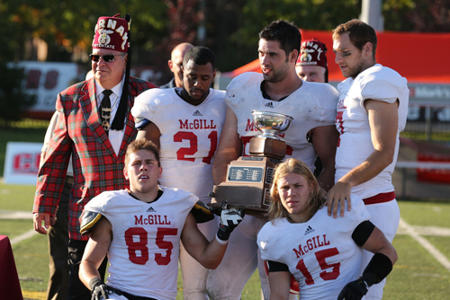 Exhausted members of the McGill Redmen football team after winning capture the 37th annual Montreal Shrine Bowl 53-52 over Concordia on Saturday. / Photo: Derek Drummond.