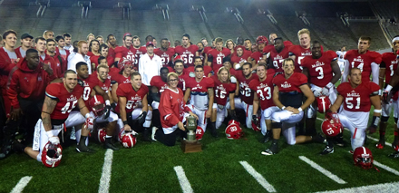 A beaming Suzanne Fortier, McGill's new Principal, poses with the Redmen football squad following the team's 32-19 to capture the 45th annual Shaughnessy Cup game. / Photo: McGill Athletics & Recreation.