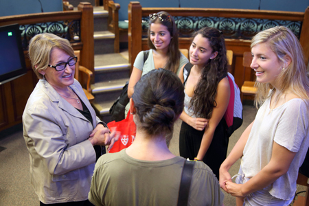Principal Suzanne Fortier, seen here chatting with a group of students, will be one of the speakers at the upcoming In Her Own Words event. / Photo: Owen Egan