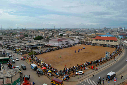 A crowd gathers as a local soccer game kicks off. / Photo: Lorenzo Daieff