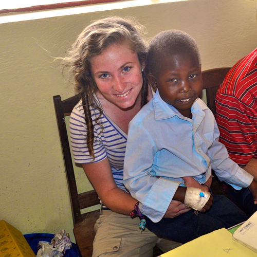 Annaliese Snodgrass and a young child she met while interning for Initiative to End Child Malnutrition in Uganda. / Photo courtesy of Annaliese Snodgrass