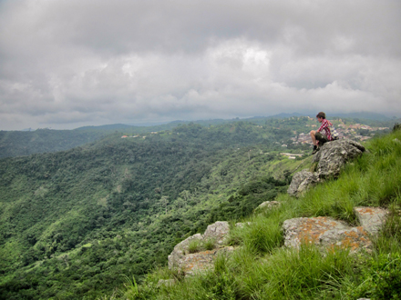 Lorenzo Daïeff takes in the view of a valley in Ghana's Volta region. The small town of Amedzofe is in the background. / Photo courtesy of Lorenzo Daïeff.