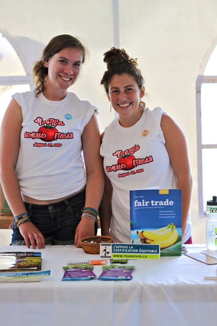 Engineers Without Borders (EWB) member Nicole McLaren (left) and EWB VP Fair Trade Jessica Hoch dispense information regarding Fair Trade during McGill's Tomato Festival earlier this month. / Photo: Victoria Leenders-Cheng.