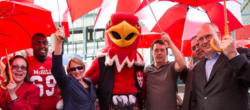 (Left to right) Lydia Martone, (Senior Liaison Officer, Office of the VP, Administration and Finance); Qadr Spooner of the Redmen football team; Principal Suzanne Fortier; Marty the Martlet; Kevin Whittaker, President of  MUNACA; Michael Di Grappa, VP (Administration and Finance); and Peter Todd, Dean of the Desautels Faculty of Management. / Photo: Leslie Schachter