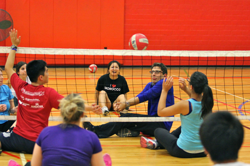 Ollivier Dyens, Deputy Provost (Student Life and Learning) sets the ball during a sitting volleyball match. / Photo: Neale McDevitt