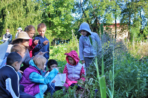 Grade schoolers, and one pink leopard, discover what is growing at Macdonald Campus. / Photo: Jacquie Rourke