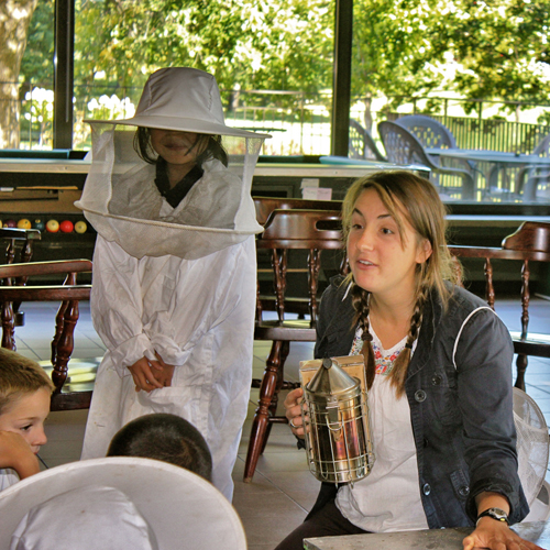 Students from École Joseph-Henrico in Baie d'Urfe get the lowdown on beekeeping. / Photo: Jacquie Rourke