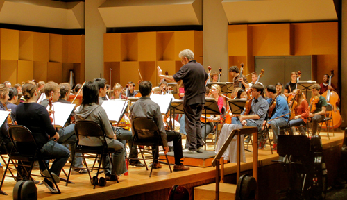 Maestro Alexis Hauser puts the McGill Symphony Orchestra through its paces in preparation for the Nov. 3 concert a the Maison Symphonique de Montreal. / Photo: Katherine Gombay