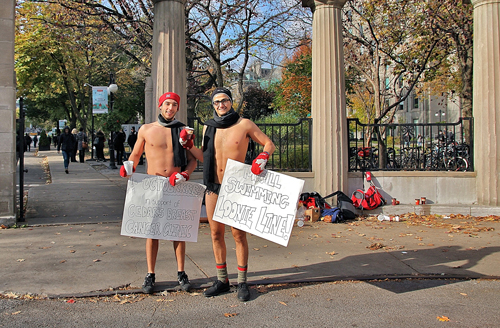 Pierre-Alexandre Renaud (left) and Sami Eid braved the chilly temperatures on Wednesday to raise money for the Cedars Cancer Institute -- an annual fundraising event for the McGill Swim Team. The goal this year is $2,000. / Photo: Neale McDevitt