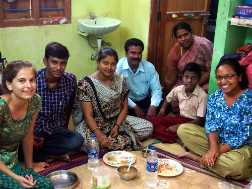 Gaëlle Perrin (far left) and Carmina Ravanera (far right) enjoying breakfast with Arivalagan (moustache), Valarmathi (in doorway), their son, and two local volunteers. / Photo courtesy of Gaëlle Perrin and Carmina Ravanera