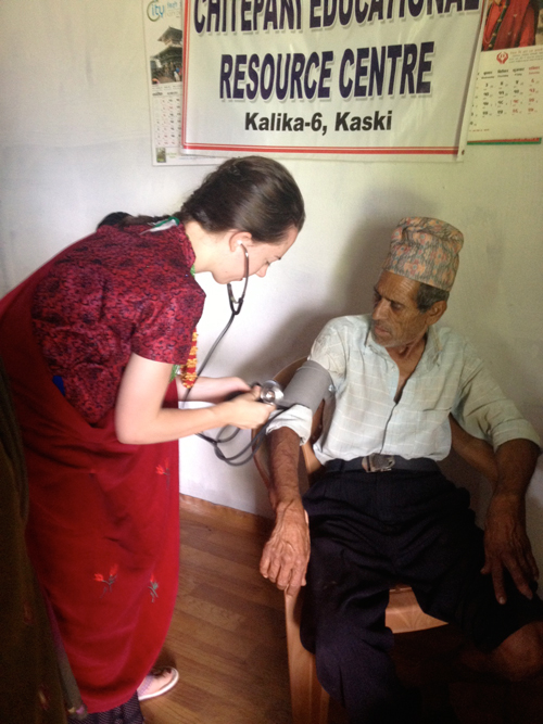 McGill Nursing student Vanessa Lavergne taking routine blood pressure measurement in rural health post in Chitepani village of Kalika district, Nepal. / Photo: Elizabeth Dickie
