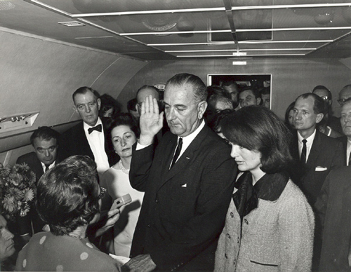Lyndon B. Johnson taking the oath of office on Air Force One following the assassination of John F. Kennedy, Dallas, Texas. / Photo: Cecil Stroughton.