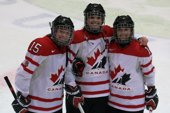 (L to R): Gabrielle Davidson, Katia Clement-Heydra and Brittney Fouracres proudly sporting Team Canada red and white instead of their regular McGill Martlet red and white. / Photo: Scott Fouracres