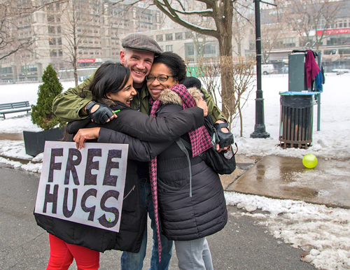 Free hugs were being doled out liberally during the Pay it Forward event on Dec. 3. / Photo: Leslie Schachter