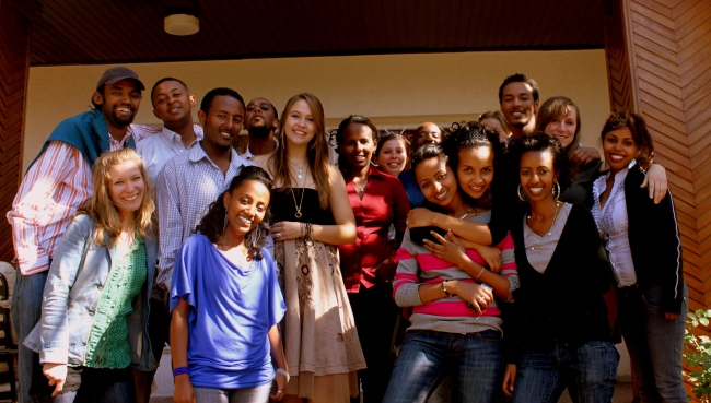 McGill Rhodes Scholar Suzanne Newing, with black top, necklaces and big smile with the DOT Ethiopia team in 2010. It was the first time she worked in Ethiopia as a volunteer, tracing success stories of youth leadership and change through photography, film, articles, and blogs.