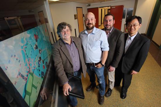 Bioengineering Chair Dan Nicolau (left) with his team's latest recruits: Allen Ehrlicher, Matt Kinsella and Brandon Xia. / Photo: Owen Egan