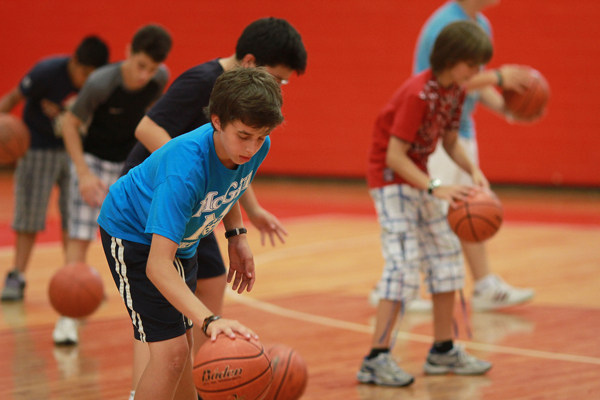Players work on their dribble at last year's March Break Basketball Camp.