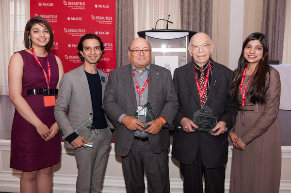 Desautels Management Achievement Awards co-chairs Shonezi Noor (far left) and Fathima Mullick (far right) flank recipients Imran Amed, Dr. Francesco Bellini, and Michal Hornstein. / Photo: Edmond Chung