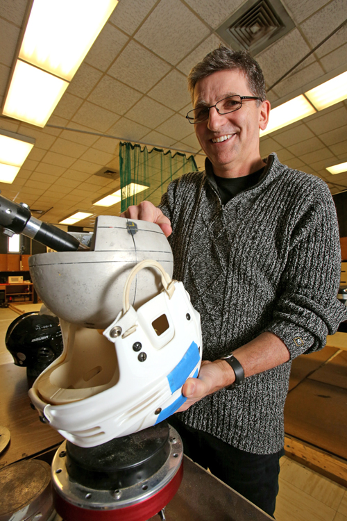 "David Pearsall, Co-Director of the McGill Ice Hockey Research Group, puts a helmet through the paces. / Photo"" Owen Egan."