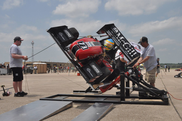 Ryan Johnson, driver and crew chief (2013 season), going through the Tilt Test to see if any fluids are leaking at the Formula SAE West in Lincoln, Nebraska. / Photo: Anna Cybulsky