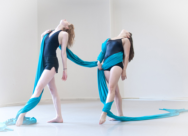 Caption: Genevieve Metson (left) and Emilie Barrette performing a dance about phosphorous, represented by the blue-green ribbon. Photo: Eve Marie Beauchemin