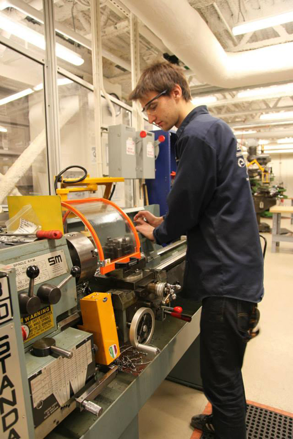 Paul Achard (2014 team captain), machining inserts for the a-arm jig in preparation for a-arm welding in the MacDonald Engineering Building Machine Tool Lab. / Photo: Jacqueline Liu (2014 MRT Photographer, Media Subteam)
