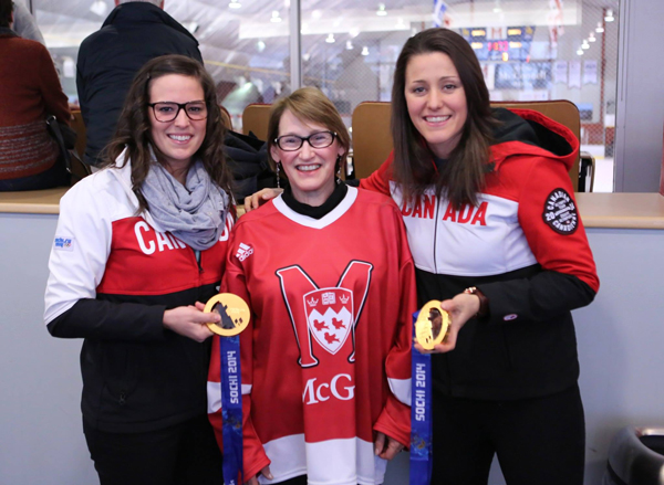 Principal Suzanne Fortier is flanked by Canadian Olympic gold medalists Melodié Daoust (left) and Charline Labonté, prior to Sunday's game between the Martlets and UdeM. / Photo: Derek Drummond
