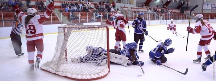 McGill's Katia Clement-Heydra (behind net) celebrates her game-winning goal. / Photo: Derek Drummond