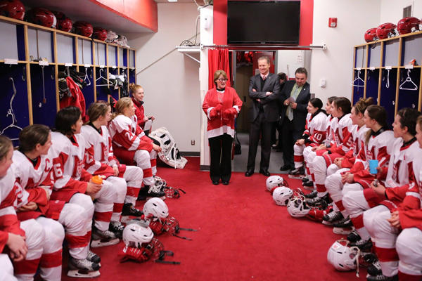 Principal Suzanne Fortier delivers some words of encouragement to the Martlets between the first and second periods of Sunday's playoff opener. / Photo: Derek Drummond