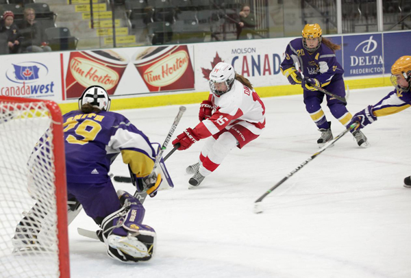 McGill's Gabrielle Davidson swoops in on goal during the Martlets' 4-1 win over  Wilfrid Laurier in the opening game of the Scotiabank CIS women's hockey championship tournament. / Photo courtesy of the cotiabank CIS women's hockey championship tournament.