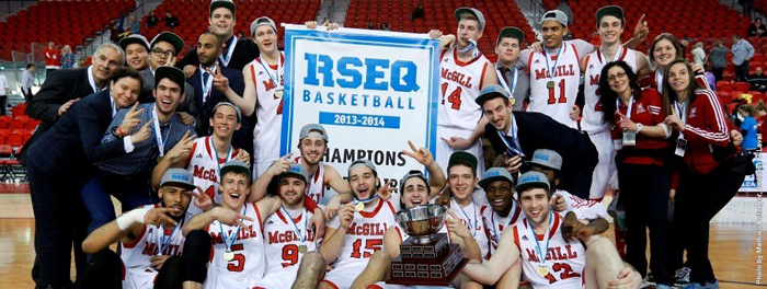 The McGill Redmen basketball team poses with the hardware after winning its second-straight RSEQ championship. / Photo: Mathieu Bélanger, courtesy of ULaval
