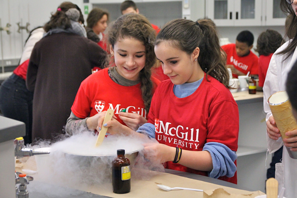 Sixth graders from F.A.C.E. school make ice cream using liquid nitrogen as part of the recent My Day @ McGill event. / Photo: Neale McDevitt