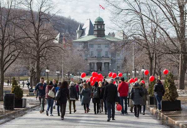 Armed with their red balloons, participants of the first-ever James McGill Walk set off to rediscover and rethink the University's lower campus.