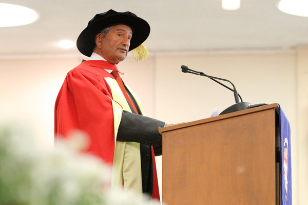 Gurdev Singh Khush gives his Convocation address during the second Mac ceremony on June 2. / Photo: Owen Egan