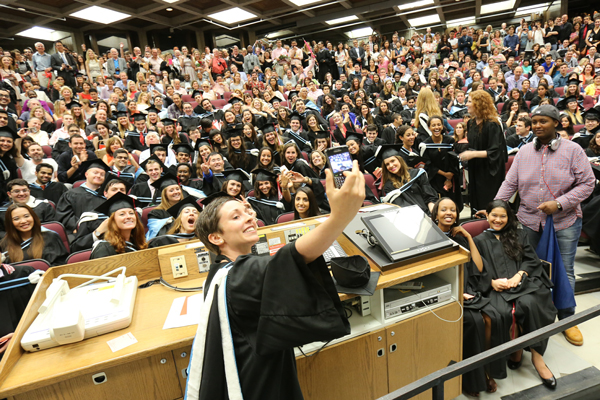 An Arts grad takes a selfie with classmates in Leacock 132 after a violent storm forced the evacuation of the Convocation tent. / Photo: Owen Egan