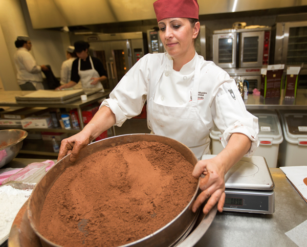 Odagiu Leruta hard at work on the giant brownie in New Residence's kitchen. / Photo: Leslie Schachter