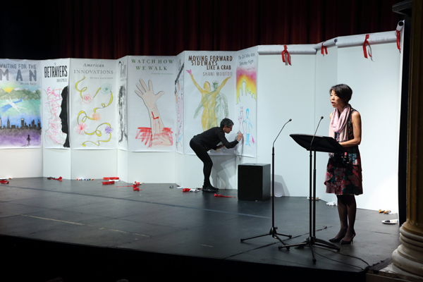 As author Denise Chong read the names of each of the longlisted books, artist Sara Heppner-Waldston produced a large poster. / Photo Owen Egan