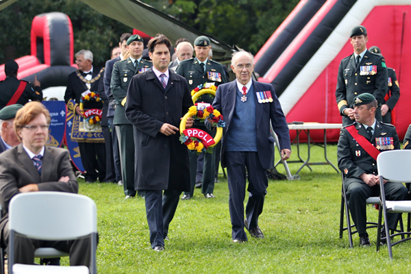 McGill's Olivier Marcil and Desmond Morton lay the first wreath during Tuesday's ceremony. / Photo: Neale McDevitt