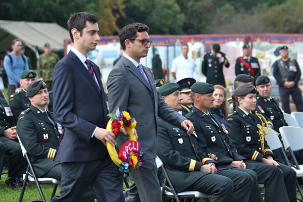 Members of the PGSS Executive, ost Graduate Students Society, Julien Ouellet  and Juan Camilo Pinto lay a wreath to honour fallen PPCLI soldiers. / Photo: Neale McDevitt