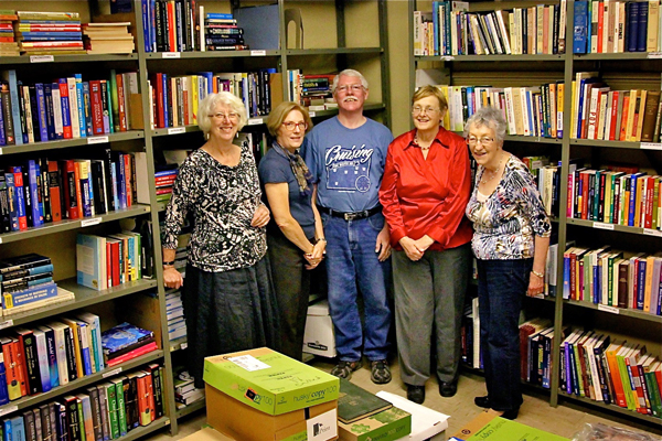 From left to right: Book Fair veterans Carly Pepler, Anne Williams, Ian Temple, Sally Cooper and Betty Couser. / Photo: Neale McDevitt